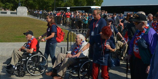 WASHINGTON, DC - OCTOBER 1:  World War II Veterans and members of the Mississippi Gulf Coast Honor Flight ascend on the Worl