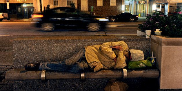 WASHINGTON, DC - SEPTEMBER 26:  A homeless man sleeps just yards from a doorway at the International Monetary Fund building