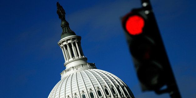 WASHINGTON, DC - SEPTEMBER 29:  A traffic light is seen in front of the United States Capitol building as Congress remains gr