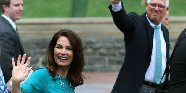 WASHINGTON, DC - JUNE 19: Rep. Michele Bachmann (R-MN) and Glenn Beck wave to supporters at a Tea Party rally in front of the