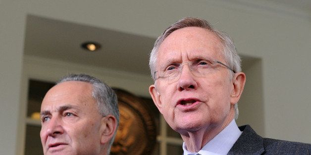 US Senate Majority Leader Harry Reid, D-NV, (R) briefs journalists following a meeting with US President Barack Obama outside