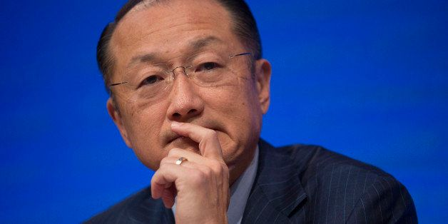 Jim Yong Kim, president of the World Bank Group, listens to a question at a news conference during the International Monetary