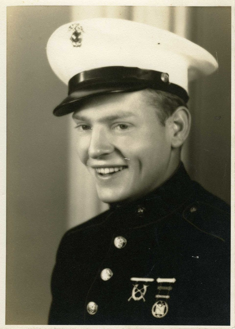 "This photo provided by the National WWII Museum shows a photo of 22-year-old Marine Cpl. Thomas ""Cotton"" Jones, who died in t"