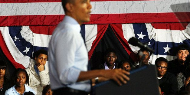 NEW YORK, NY - OCTOBER 25: Students watch as U.S. President Barack Obama speaks at the Pathways in Technology Early College H