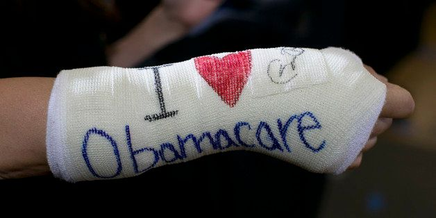 BOSTON - OCTOBER 30: Cathey Park, of Cambridge, displayed a cast on her broken wrist with 'I (heart) Obamacare' written on it