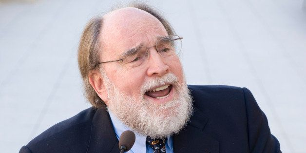 UNITED STATES - APRIL 17:  Holding a Univ. of Hawaii football, Rep. Neil Abercrombie, D-Hawaii, participates in a news confer