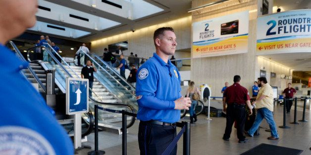 LOS ANGELES, CA - NOVEMBER 1: Transportation Security Administration workers keep a look out as stranded passengers begin to