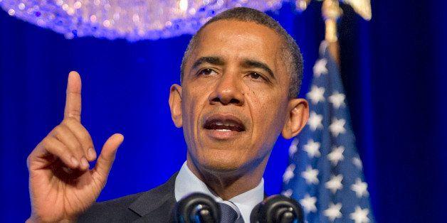 WASHINGTON, DC - NOVEMBER 04:  US President Barack Obama delivers remarks at an Organizing for Action 'Obamacare Summit' at t