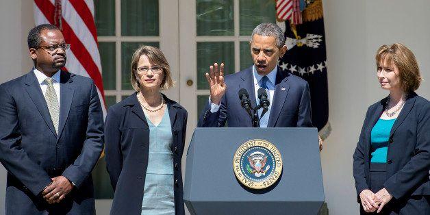 US President Barack Obama (C) gestures as he nominates Cornelia T. L. Pillard (R), a law professor; Patricia Ann Millett (2nd