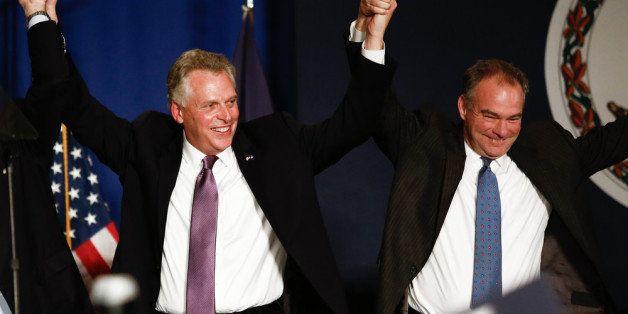 TYSONS CORNER, VA - NOVEMBER 5: (L-R), Virginia Governor-elect Terry McAuliffe (D) and Sen. Tim Kaine (D-VA) raise their hand