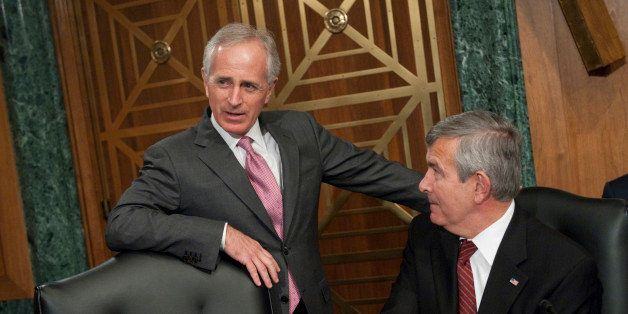 UNITED STATES - JANUARY 31:  Sens. Bob Corker, R-Tenn., left, and Mike Johanns, R-Neb., talk before the start of a Senate Ban
