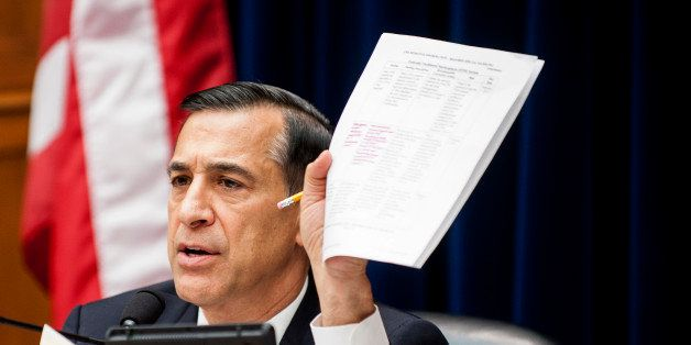 Representative Darrell Issa, a Republican from California, refers to a document while he chairs a House Oversight and Governm