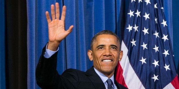 WASHINGTON, DC - NOVEMBER 13:  U.S. President Barack Obama waves while attending the 2013 Tribal Nations Conference held at t