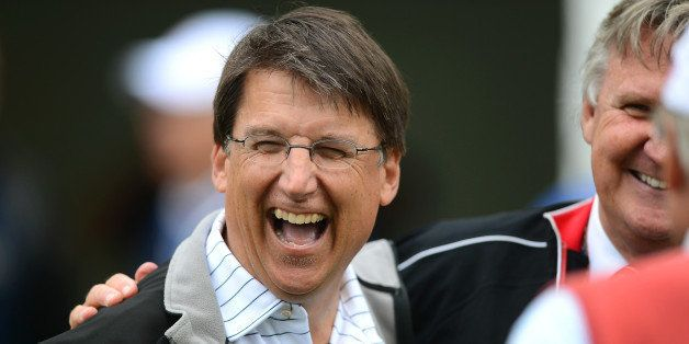 North Carolina Governor Pat McCrory enjoys a laugh at the 10th tee during the Pro-Am at Quail Hollow Club ahead of the Wells