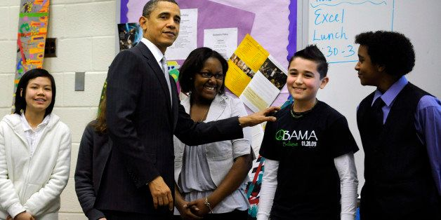 ARLINGTON, VA - MARCH 14:  (AFP OUT) U.S. President Barack Obama visits with students in a classroom while at Kenmore Middle