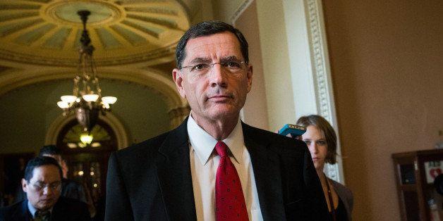 WASHINGTON, DC - OCTOBER 14:  Sen. John Barrasso (R-WY) walks through the Capitol Building on October 14, 2013 in Washington,
