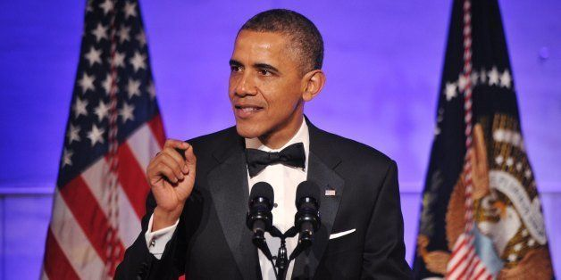 US President Barack Obama addresses a dinner honoring Medal of Freedom recipients on November 20, 2013 at the Smithsonian Nat