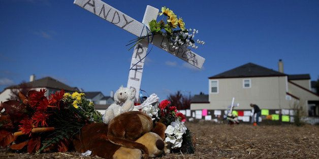 SANTA ROSA, CA - OCTOBER 29: Flowers and stuffed toys sit at a memorial for 13 year-old Andy Lopez who was shot by a Sonoma County sheriff deputy last week on October 29, 2013 in Santa Rosa, California. 13 year-old Andy Lopez was shot and killed by a Sonoma County sheriff deputy as he carried a toy replica of an AK-47 assualt rifle one week ago. (Photo by Justin Sullivan/Getty Images)