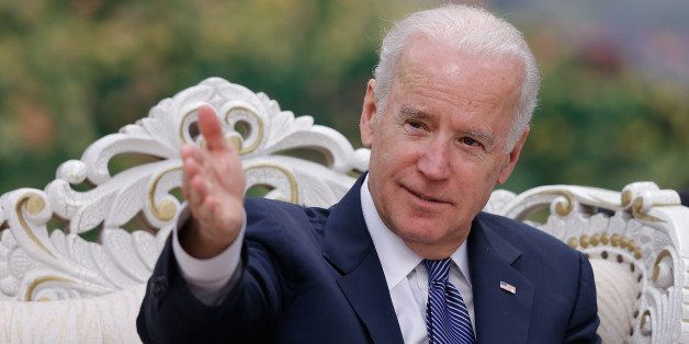 US Vice President Joe Biden gestures during a meeting with Chinese Vice President Li Yuanchao (unseen) after a welcoming cere