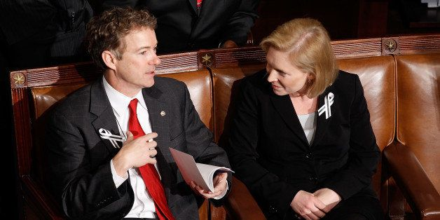 WASHINGTON, DC - JANUARY 25: (L-R) Sen. Rand Paul (R-KY) (L) and Sen. Kirsten Gillibrand (D-NY) talk before U.S. President Barack Obama's State of the Union address on Capitol Hill on January 25, 2011 in Washington, DC. Sen. Mark Udall (D-CO) first proposed bipartisan seating arrangements to foster a more cooperative spirit among lawmakers. (Photo by Chip Somodevilla/Getty Images)