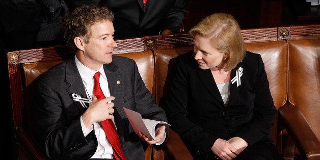 WASHINGTON, DC - JANUARY 25:  (L-R) Sen. Rand Paul (R-KY) (L) and Sen. Kirsten Gillibrand (D-NY) talk before U.S. President B