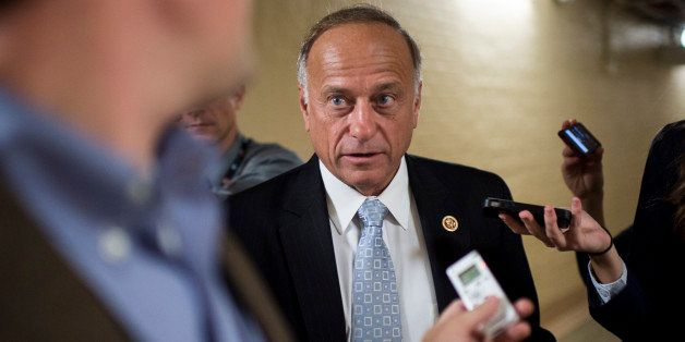 UNITED STATES - OCTOBER 4: Rep. Steve King, R-Iowa, speaks with reporters as he leaves the House Republican Conference meetin