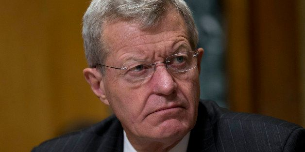 Senator Max Baucus, a Democrat from Montana and chairman of the Senate Finance Committee, listens during a hearing with Kathl