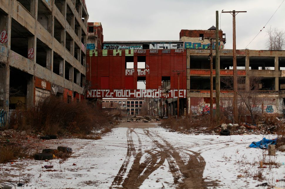 Graffiti is painted on the walls of the abandoned Packard Automotive Plant in Detroit, Mich. The city filed for Chapter 9 ban