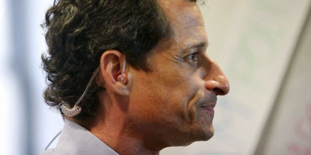 NEW YORK, NY - SEPTEMBER 09:  Democratic mayoral candidate Anthony Weiner waits to be interviewed while working the phone ban