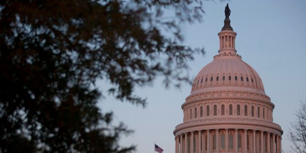 The U.S. Capitol stands at sunset in Washington, D.C., U.S., on Thursday, Dec. 12, 2013. A U.S. budget accord is on track to