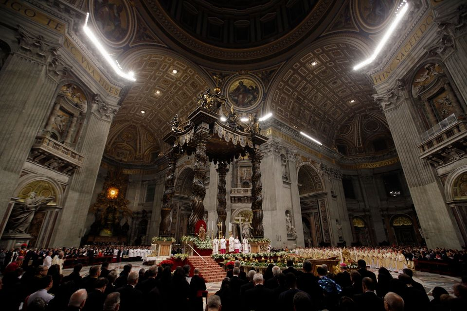 Pope Francis celebrates the Christmas Eve Mass in St. Peter's Basilica at the Vatican, Tuesday, Dec. 24, 2013. Pope Francis h