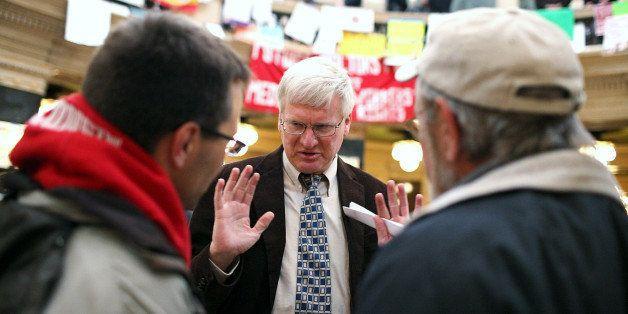 MADISON, WI - MARCH 04:  Republican Wisconsin State Senator Glenn Grothman (C) talks with Mark Dziedzic (L) and Jeff Dziedzic