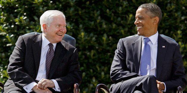ARLINGTON, VA - JUNE 30:  United States Secretary of Defense Robert Gates (L) and President Barack Obama share a laugh during