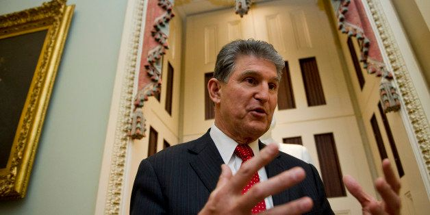 UNITED STATES - Jan 14: Sen. Joe Manchin, D-WVA., talks with reporters on the way to the Senate policy luncheons in the U.S.