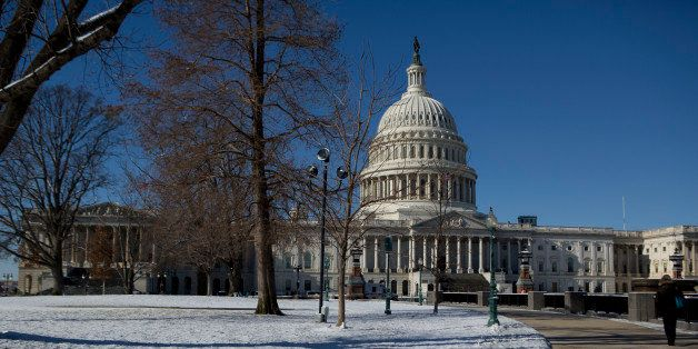 A pedestrian walks near the U.S. Capitol in Washington, D.C., U.S., on Friday, Jan. 3, 2014. A storm along the U.S. East Coas