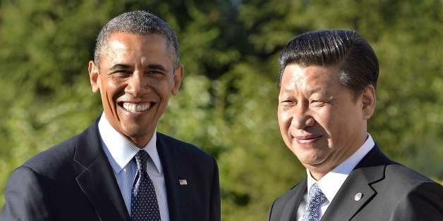 US President Barack Obama (L) is greeted by Chinese President Xi Jinping for a bilateral meeting in Saint Petersburg on Septe