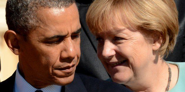 US President Barack Obama (L) stands nearby Germanys Chancellor Angela Merkel during the family picture of the G20 summit in