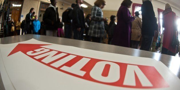 People queue to cast their ballots at a polling station in Washington,DC on November 6, 2012. Americans head to the polls aft