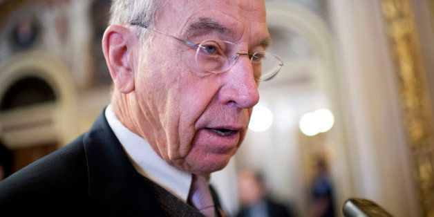 UNITED STATES - NOVEMBER 21: Sen. Charles Grassley, R-Iowa, talks with reporters in the Capitol after a vote in the Senate to