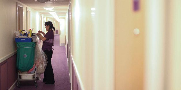 A chambermaid prepares her cleaning trolley at a Premier Inn hotel at Heathrow airport in London, U.K., on Friday, April 20,