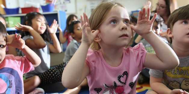 SAN DIEGO, CA - OCTOBER 01:  Children at Scripps Ranch KinderCare in San Diego play in their classroom on October 1, 2013 in