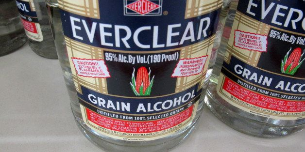 This Dec. 30, 2013 photo shows bottles of Everclear, 190 Proof grain alcohol, for sale at a grocery store in Madison, Wis. A