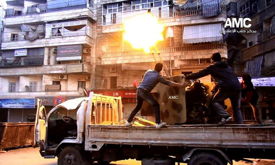 Syrian rebels fire their anti-aircraft gun at Syrian government airplanes in Aleppo, in this Saturday Feb. 1, 2014 photo prov
