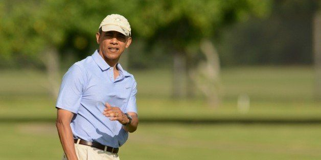 KANEOHE, HI - JANUARY 2:  U.S. President Barack Obama lines up his putt on the second green while golfing with the Prime MIni