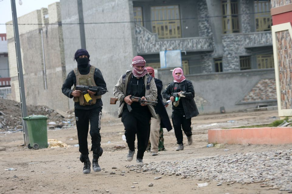Gunmen patrol during clashes with Iraqi security forces in Fallujah, Iraq in this Jan. 5, 2014 picture. (AP Photo)