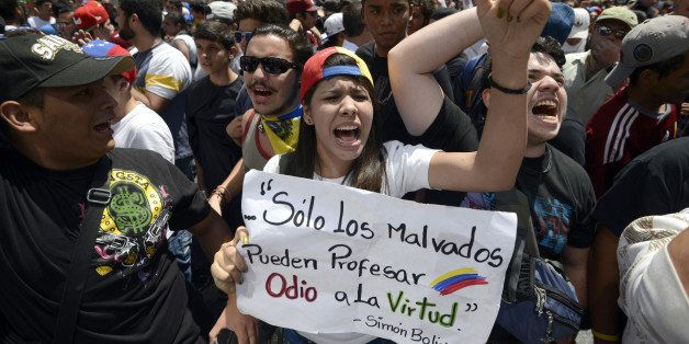 Students shout slogans during an opposition demo against the government of Venezuelan President Nicolas Maduro, in Caracas on