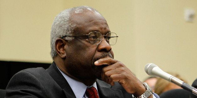 WASHINGTON - APRIL 15:  U.S. Supreme Court Justices Clarence Thomas (L) and Stephen Breyer (R) testify during a hearing befor
