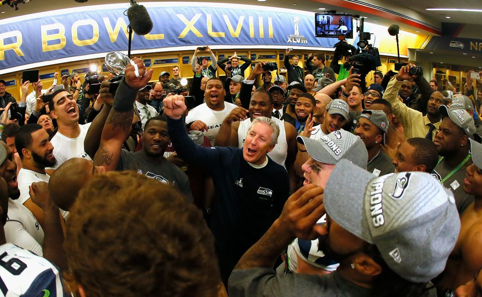 EAST RUTHERFORD, NJ - FEBRUARY 02:  Head coach Pete Carroll of the Seattle Seahawks gives his team a speech in the locker roo