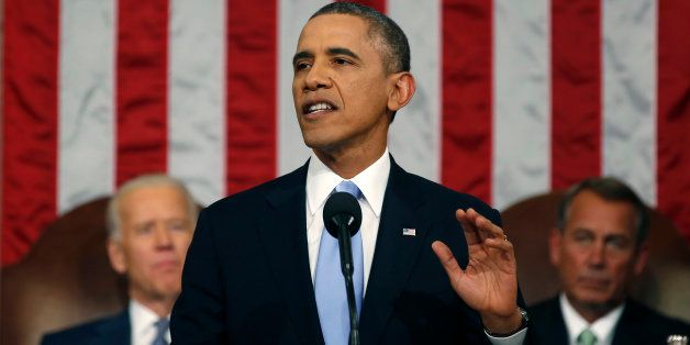 U.S. President Barack Obama, center, delivers the State of the Union address to a joint session of Congress as U.S. Vice Pres
