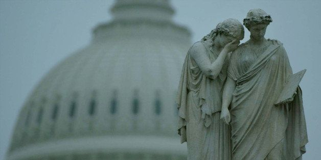 WASHINGTON - OCTOBER 25:  A weeping statue stands in front of the U.S. Capitol October 25, 2002 in Washington, DC. U.S. Senat
